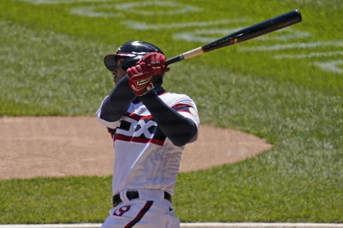 Chicago White Sox's Jose Abreu hits a two-run home run against the Texas Rangers during the first inning of a baseball game in Chicago, Sunday, April 25, 2021. (AP Photo/Nam Y. Huh)