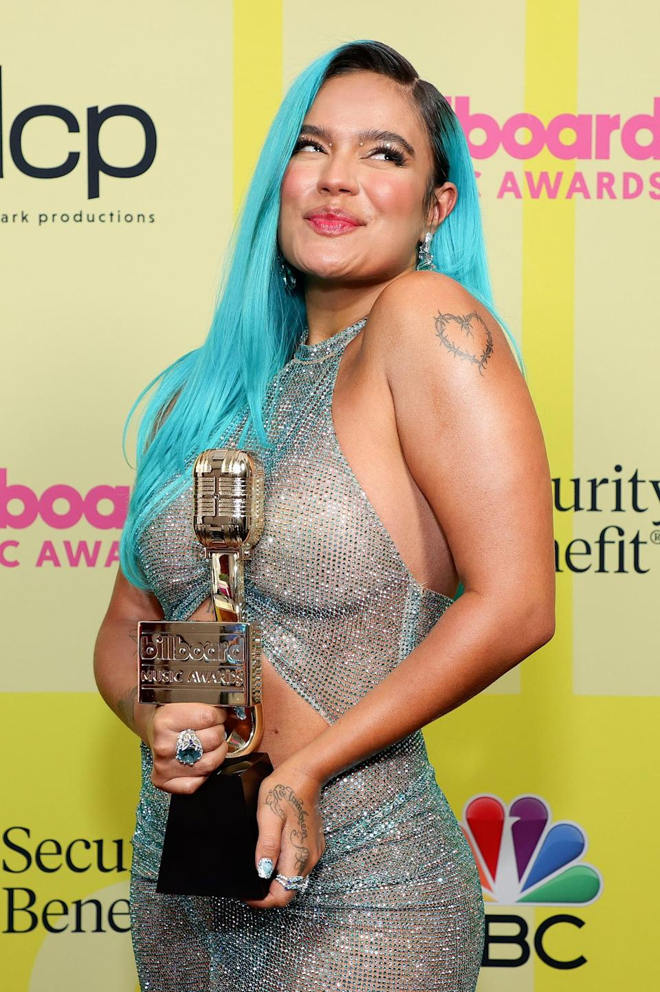 <p>Karol G was blinged out from her eyelids to her her fingertips - check out that bedazzled manicure - but we think her electric blue hair color stole the show.</p>