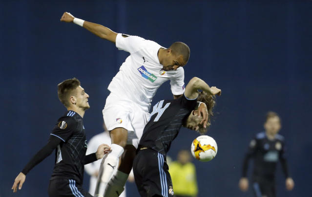 In this file picture taken on Thursday, Feb. 21, 2019, Plzen midfielder Jean-David Beauguel, center, jumps for the ball with Dinamo Zagreb's Amer Gojak, right, during the Europa League round of 32 second leg soccer match between Dinamo Zagreb and Viktoria Plzen at Maksimir Stadium in Zagreb, Croatia. On Monday June 15, 2020, the top Czech league has condemned racist abuse of a player by fans during a league game. The incident occurred on Sunday at the game between Olomouc and Plzen when several fans directed racist insults at Plzen striker Jean-David Beauguel who is black. The 28-year-old is a French national. (AP Photo/Darko Bandic/File)