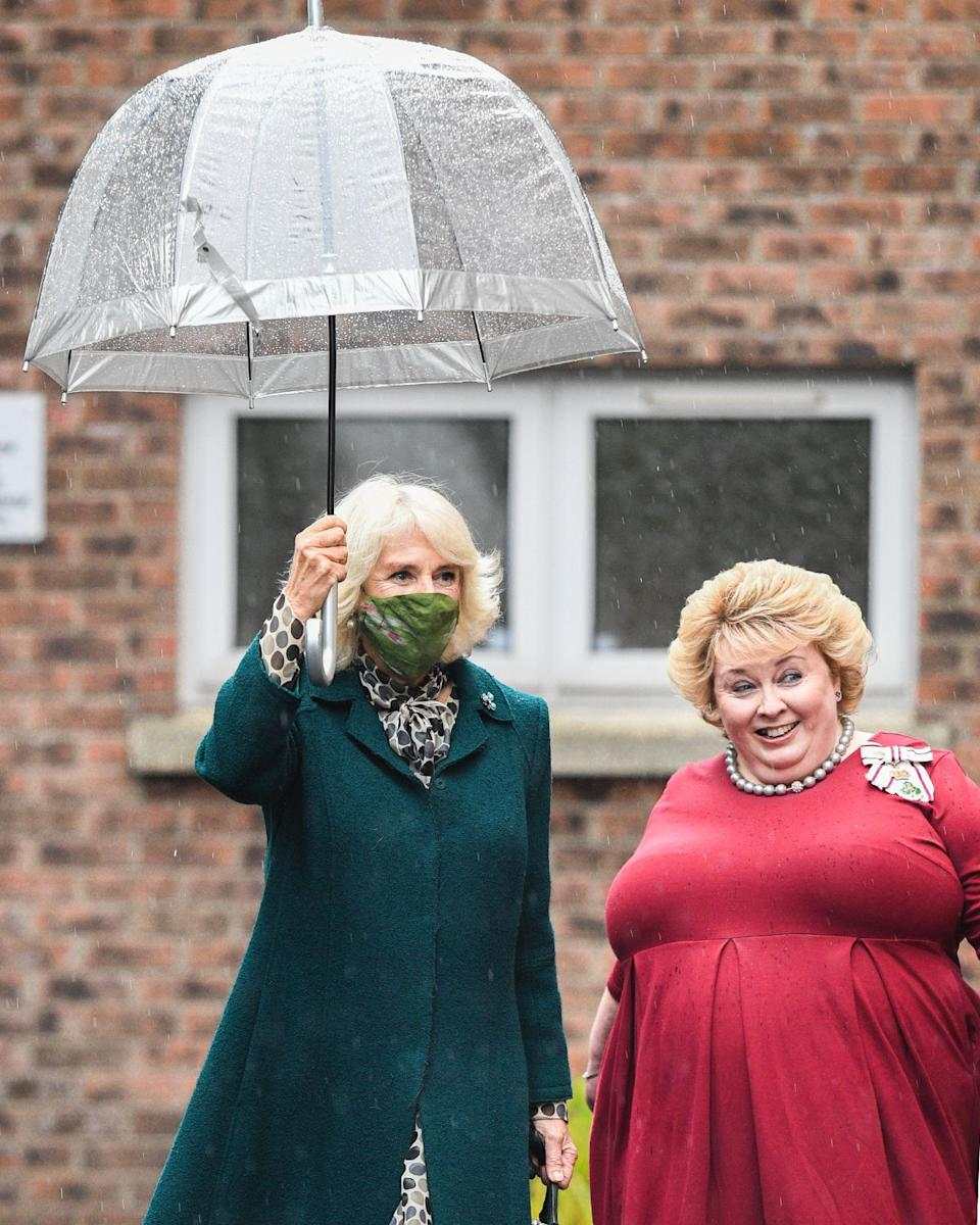 Britain's Camilla, Duchess of Cornwall wears a face mask or covering due to the COVID-19 pandemic during a visit to the Belfast & Lisburn Women's Aid which supports those affected by domestic violence, in Belfast on September 30, 2020. (Photo by Tim Rooke / POOL / AFP) (Photo by TIM ROOKE/POOL/AFP via Getty Images)