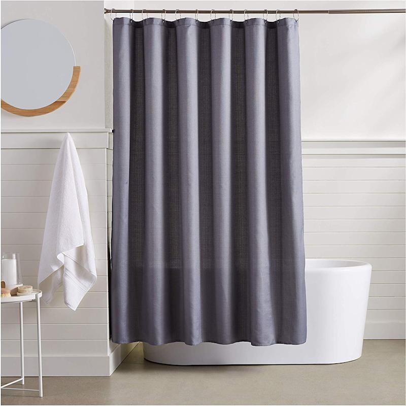 This linen style curtain gives a hotel-like vibe to even the plainest bathroom. (Photo: Amazon)