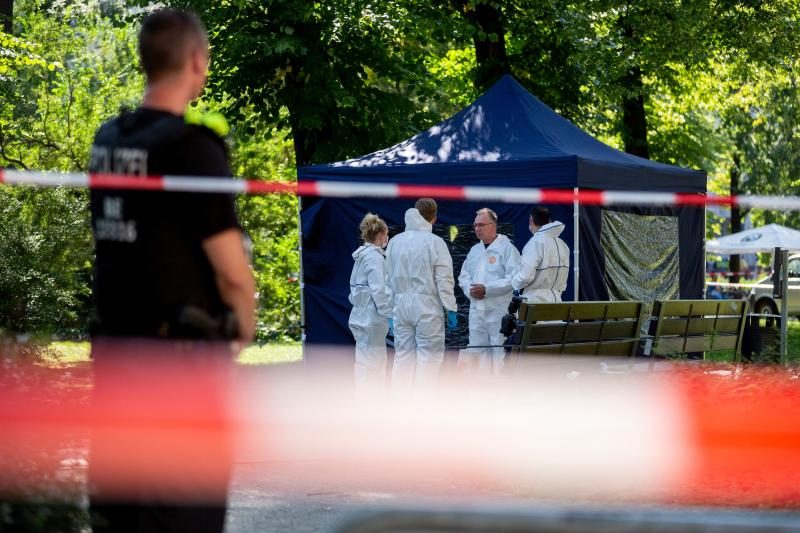 "Picture taken on August 23, 2019 shows forensic experts of the police securing evidences at the site of a crime scene in Berlin's Moabit district, where a man of Georgian origin was shot dead. - German police were investigating on August 25, 2019 the assassination-style killing in a Berlin park of the Georgian man who was reportedly a former special forces commando and Chechnya war veteran. Police have arrested a 49-year-old suspect from Russia's Chechnya republic over the murder of the man media identified as Zelimkhan Khangoshvili. The killer had approached his victim from behind, as he was on his way to a mosque, shot him and fled by bicycle in what one witness described as an ""execution"" style killing. (Photo by Christoph Soeder / dpa / AFP) / Germany OUT (Photo credit should read CHRISTOPH SOEDER/DPA/AFP via Getty Images)"