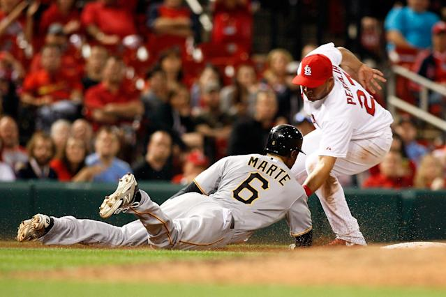 Pittsburgh Pirates' Starling Marte (6) is tagged out by St. Louis Cardinals shortstop Jhonny Peralta after getting caught in a rundown during the eighth inning of a baseball game on Friday, April 25, 2014, in St. Louis. (AP Photo/Scott Kane)