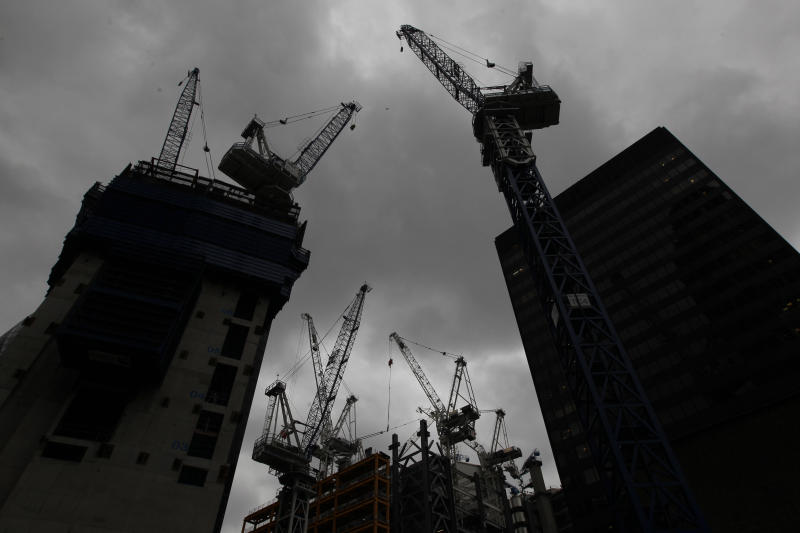 FILE - This Friday, June 29, 2012 file photo shows construction cranes of new buildings in London's City financial district. The British economy grew by 0.6 percent in the first quarter compared with the previous three months, amid strong performances from nearly all the country's main industries. The increase in annual gross domestic product, as reported by the Office for National Statistics Thursday July 25, 2013, was double the previous quarter's rate but in line with market expectations. The UK's service, agriculture, manufacturing and construction industries all posted increases. (AP Photo/Lefteris Pitarakis, File)