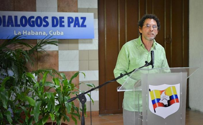 Commander of the FARC-EP leftist guerrilla delegation, Pastor Alape, reads a statement at the Convention Palace in Havana on May 27, 2015 (AFP Photo/Adalberto Roque)
