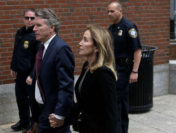 PHOTO: Felicity Huffman arrives with her brother Moore Huffman Jr., at federal court, May 13, 2019, in Boston, where she is scheduled to plead guilty to charges in a nationwide college admissions bribery scandal. (Steven Senne/AP)