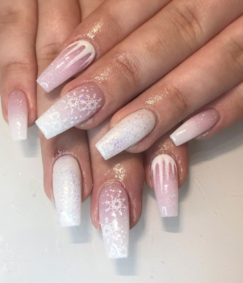"<p>If you dream of a white Christmas every year, you can at least make it happen on your nails just like <a href=""https://www.instagram.com/nailsxjacqui/"" rel=""nofollow noopener"" target=""_blank"" data-ylk=""slk:nail artist Jacqui"" class=""link rapid-noclick-resp"">nail artist Jacqui</a> did here. To make it extra easy, opt for press-ons.</p><p><a class=""link rapid-noclick-resp"" href=""https://go.redirectingat.com?id=74968X1596630&url=https%3A%2F%2Fwww.etsy.com%2Flisting%2F649756940%2Fwinter-wonderland-set-christmas-gel&sref=https%3A%2F%2Fwww.oprahmag.com%2Fbeauty%2Fg34113691%2Fchristmas-nail-ideas%2F"" rel=""nofollow noopener"" target=""_blank"" data-ylk=""slk:SHOP PRESS-ON NAILS"">SHOP PRESS-ON NAILS</a></p>"