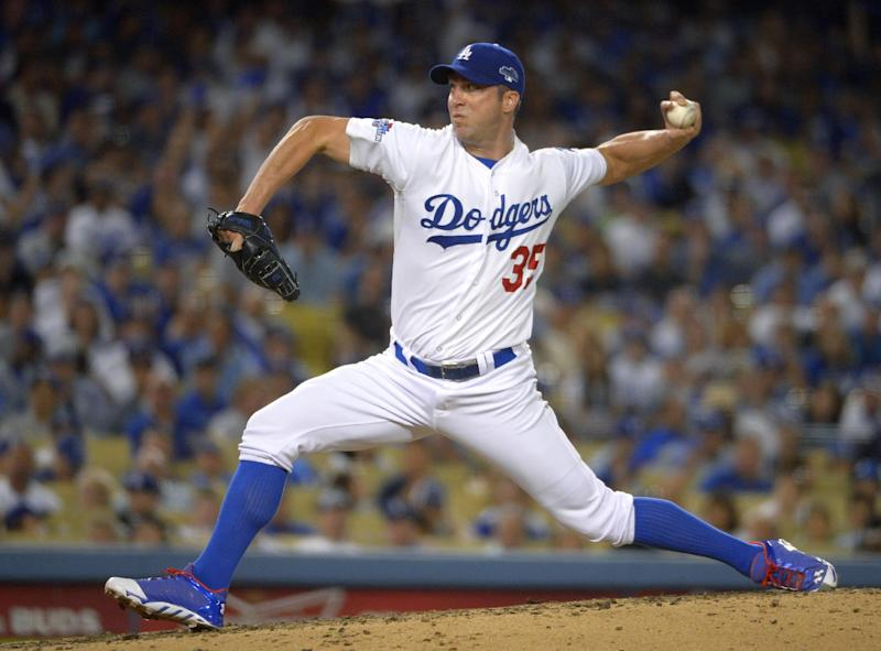 Los Angeles Dodgers pitcher Chris Capuano throws in the fourth inning in Game 3 of the National League division baseball series against the Atlanta Braves, Sunday, Oct. 6, 2013, in Los Angeles. (AP Photo/Mark J. Terrill)