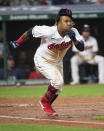 Cleveland Indians' Jose Ramirez runs out an infield hit off Chicago White Sox relief pitcher Ryan Burr during the sixth inning of a baseball game in Cleveland, Friday, Sept. 24, 2021. (AP Photo/Phil Long)