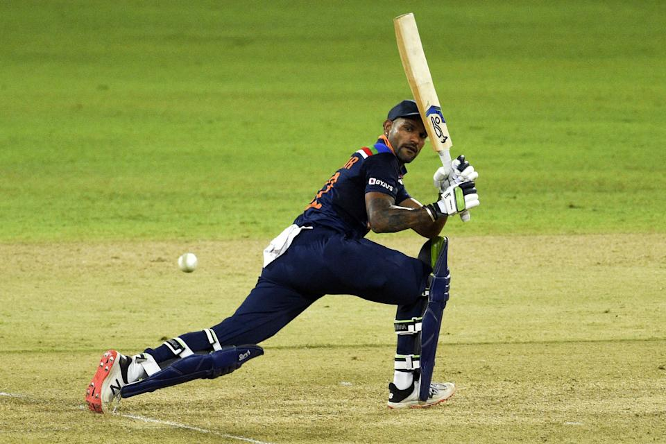 India's cricket captain Shikhar Dhawan plays a shot during the first One Day International (ODI) cricket match between Sri Lanka and India at the R.Premadasa Stadium in Colombo on July 18, 2021. (Photo by ISHARA S.  KODIKARA / AFP) (Photo by ISHARA S.  KODIKARA/AFP via Getty Images)
