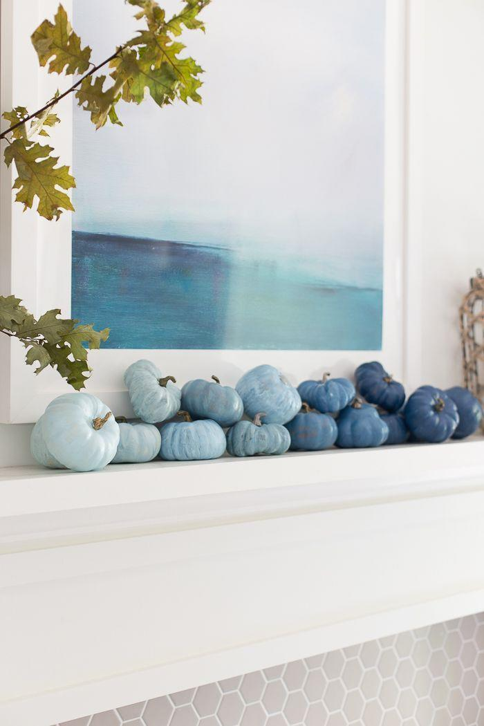 """<p>Perhaps you'd prefer a crisp, coastal take on your fall mantel décor. Here, you'll make a grouping of pumpkins in shades of blue for a sea-inspired look. </p><p><strong>Get the tutorial at <a href=""""https://www.makinghomebase.com/painting-faux-pumpkins/"""" rel=""""nofollow noopener"""" target=""""_blank"""" data-ylk=""""slk:Making Home Base"""" class=""""link rapid-noclick-resp"""">Making Home Base</a>.</strong></p><p><a class=""""link rapid-noclick-resp"""" href=""""https://go.redirectingat.com?id=74968X1596630&url=https%3A%2F%2Fwww.walmart.com%2Fip%2F4-Pcs-Artificial-Pumpkins-Rustic-Faux-Pumpkin-White-Orange-Fall-Decor-Autumn-Harvest-D-cor-Farmhouse-Mantel-Decorations-Thanksgiving-Halloween-Center%2F720698921&sref=https%3A%2F%2Fwww.thepioneerwoman.com%2Fhome-lifestyle%2Fcrafts-diy%2Fg36891743%2Ffall-mantel-decorations%2F"""" rel=""""nofollow noopener"""" target=""""_blank"""" data-ylk=""""slk:SHOP FAUX PUMPKINS"""">SHOP FAUX PUMPKINS</a></p>"""