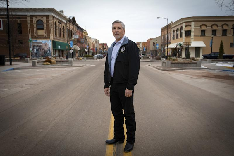 496204_ME_la-na-census-prison-gerrymandering_04.FO.jpgState Sen. Dennis Hisey, a Republican from the Cañon City area, stands on Main Street in Cañon City.