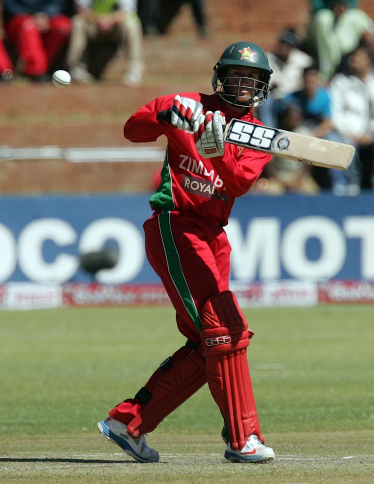 Zimbabwe's batsman Sean Williams plays a shot during the final game of the 5 match cricket ODI series between Zimbabwe and India at the Queens Sports Club in Harare, on August 3, 2013. AFP PHOTO / JEKESAI NJIKIZANA        (Photo credit should read JEKESAI NJIKIZANA/AFP/Getty Images)