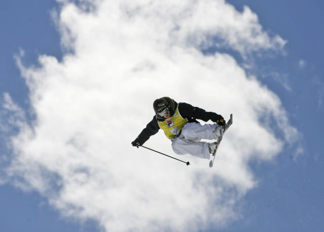 Sarah Burke of Canada is airborne on her way to win the women's halfpipe freestyle title at the World Cup finals in Valmalenco, Italy, Wednesday, March 12, 2008 (AP Photo/Alessandra Tarantino)