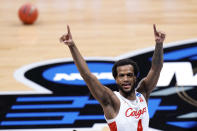 Houston forward Justin Gorham (4) celebrates beating Syracuse 62-46 after a Sweet 16 game in the NCAA men's college basketball tournament at Hinkle Fieldhouse in Indianapolis, Saturday, March 27, 2021. (AP Photo/AJ Mast)