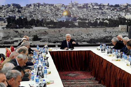 Palestinian President Mahmoud Abbas gestures as he speaks during a meeting with the Palestinian leadership in Ramallah, in the occupied West Bank March 19, 2018. Palestinian President Office (PPO)/Handout via REUTERS