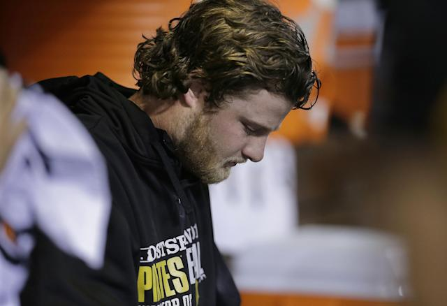 Pittsburgh Pirates starting pitcher Gerrit Cole sits in the dugout in the fifth inning of Game 5 of a National League baseball division series between the Pirates and the St. Louis Cardinals on Wednesday, Oct. 9, 2013, in St. Louis. The Cardinals won 6-1. (AP Photo/Charlie Riedel)