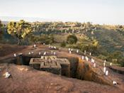 """In northern Ethiopia, the small town of <a href=""""https://www.cntraveler.com/gallery/the-sacred-rock-churches-of-lalibela-ethiopia?mbid=synd_yahoo_rss"""" rel=""""nofollow noopener"""" target=""""_blank"""" data-ylk=""""slk:Lalibela"""" class=""""link rapid-noclick-resp"""">Lalibela</a> is known for its eleven medieval churches carved out of monolithic rock. The churches, which date all the way back to the 12th century, come complete with catacombs and ceremonial passages; some even have networks of trenches that connect them to the other buildings. Although ancient, the structures still welcome pilgrimages today."""