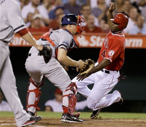 Los Angeles Angels' Torii Hunter, right, scores past Boston Red Sox catcher Ryan Lavarnway on a single by Mark Trumbo during the third inning of an baseball in Anaheim, Calif., Thursday, Aug. 30, 2012. (AP Photo/Chris Carlson)