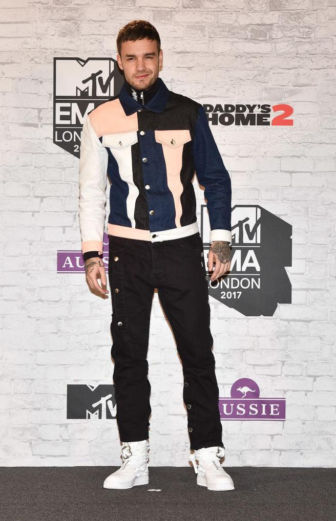 <p>Liam Payne gave color-blocking a go at the awards night in a denim jacket and jeans. (Photo: Getty Images) </p>