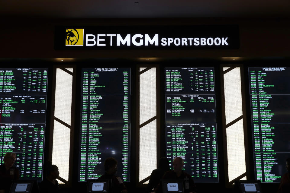 Odds are shown during the launch of legalized sports betting in Michigan at the MGM Grand Detroit casino in Detroit, Wednesday, March 11, 2020. (AP Photo/Paul Sancya)
