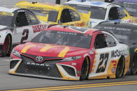 Bubba Wallace runs in the lead during a NASCAR Cup series auto race Monday, Oct. 4, 2021, in Talladega, Ala. Wallace was ahead when a rain delay was called and pronounced the winner when the decesion was made to end the race early. (AP Photo/Greg McWilliams)