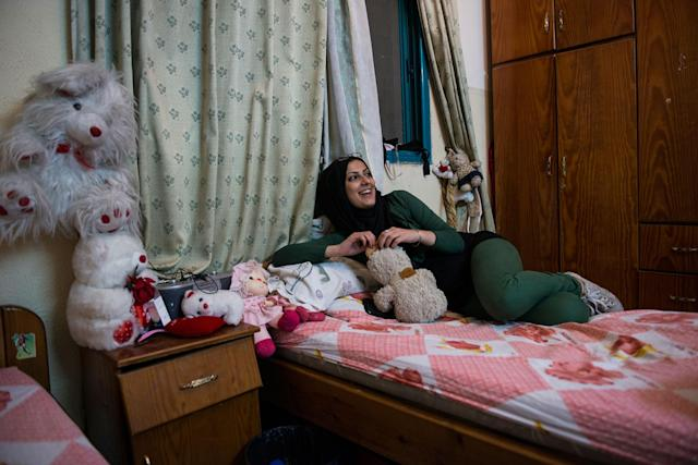 <p>Doaa in a friend's bedroom. Girls that are unmarried have few places to be themselves. Bedrooms and private cars are sanctuaries where girls can sing and dance without being judged by the public or their own families. (Photograph by Monique Jaques) </p>