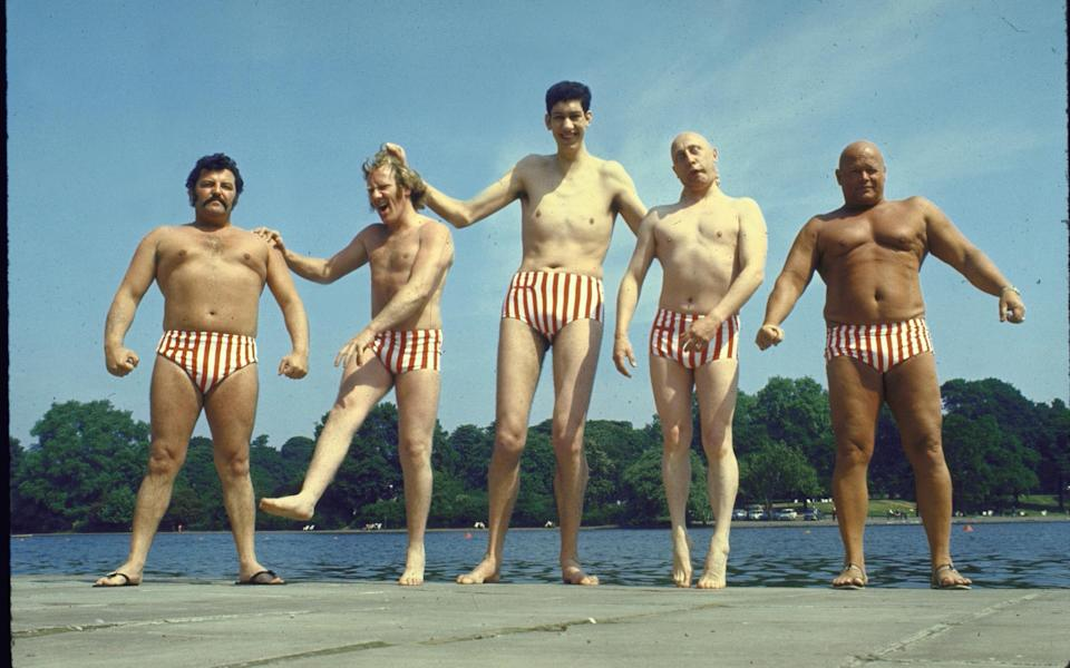 Varied assortment of male models who work for the London agency UGLY posing in striped bathingsuits. (Photo by Loomis Dean/The LIFE Picture Collection via Getty Images) - Getty