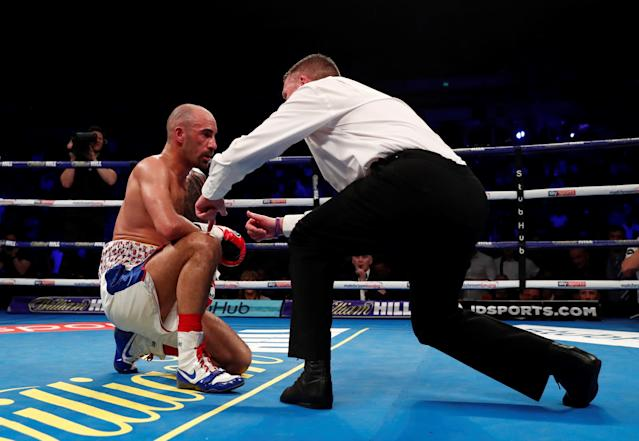 Boxing - Sean Dodd v Tommy Coyle - Commonwealth Lightweight Title - Echo Arena, Liverpool, Britain - April 21, 2018 Sean Dodd receives a count from the referee after being knocked down by Tommy Coyle Action Images via Reuters/Andrew Couldridge