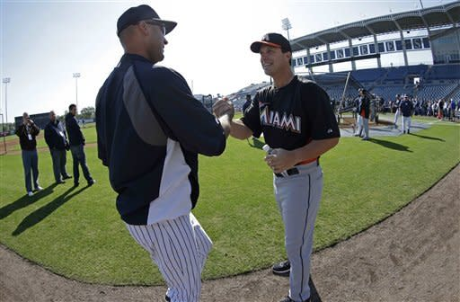 New York Yankees shortstop Derek Jeter, left, and former Yankees first baseman and current Miami Marlins hitting instructor Tino Martinez before a spring training baseball game in Tampa, Fla., Friday, March 15, 2013. (AP Photo/Kathy Willens)