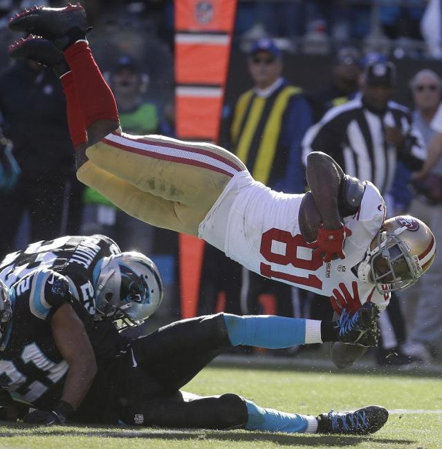 San Francisco 49ers wide receiver Anquan Boldin (81) makes a catch as Carolina Panthers cornerback Melvin White (23) and Carolina Panthers free safety Mike Mitchell, left, defend during the first half of a divisional playoff NFL football game, Sunday, Jan. 12, 2014, in Charlotte, N.C. (AP Photo/John Bazemore)