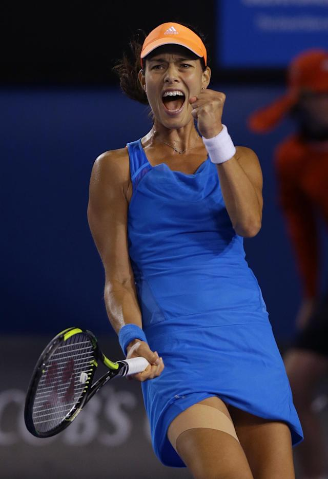 Ana Ivanovic of Serbia celebrates a match point won over Samantha Stosur of Australia during their third round match at the Australian Open tennis championship in Melbourne, Australia, Friday, Jan. 17, 2014.(AP Photo/Aaron Favila)