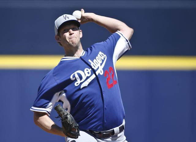 FILE - In this March 15, 2015, file photo, Los Angeles Dodgers starting pitcher Clayton Kershaw works against the Seattle Mariners in the first inning of a spring training baseball game in Peoria, Ariz. The average salary when opening-day rosters are finalized Sunday will break the $4 million barrier for the first time, according to a study of all major league contracts by The Associated Press. Dodgers pitcher Clayton Kershaw tops players at $31 million and Los Angeles leads teams at nearly $273 million, easily a record.(AP Photo/Lenny Ignelzi, File)
