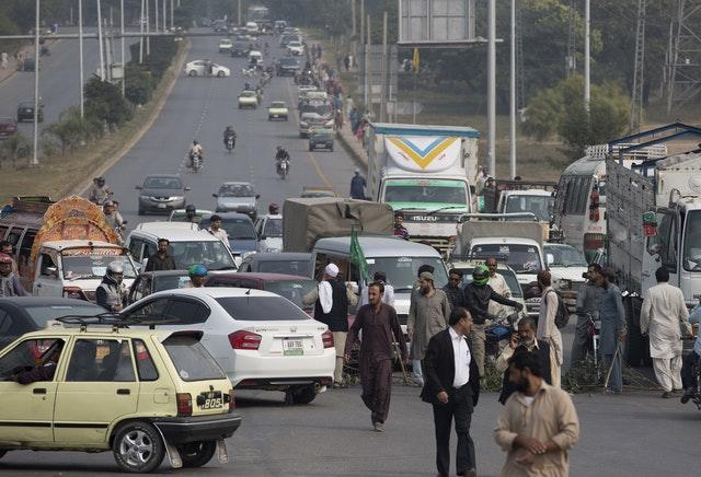 Protesters block a main road in Islamabad