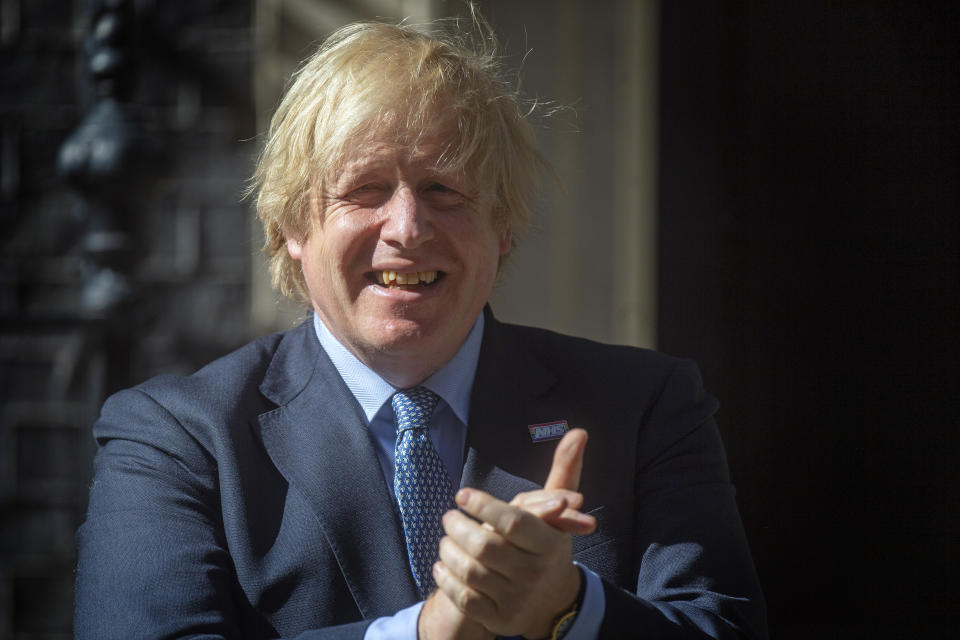 As part of the NHS birthday celebrations, Prime Minister Boris Johnson joins in the pause for applause to salute the NHS 72nd birthday outside 10 Downing Street, London.