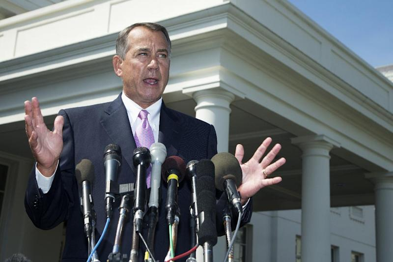"""FILE - In this Sept. 3, 2013, file photo House Speaker John Boehner of Ohio speaks to reporters outside the White House in Washington. As lawmakers end their five-week recess, no member of Congress is in a tighter spot than Boehner, who risks seeing most of his Republican colleagues vote against him on three major issues, Syria, the debt limit, and immigration reform. More than a third of House Republicans have urged Boehner to trigger a government shutdown rather than fund the implementation of """"Obamacare"""". (AP Photo/Manuel Balce Ceneta, File)"""