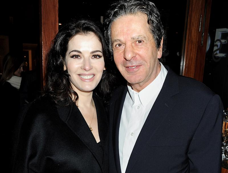 LONDON, ENGLAND - JANUARY 19: (EMBARGOED FOR PUBLICATION IN UK TABLOID NEWSPAPERS UNTIL 48 HOURS AFTER CREATE DATE AND TIME. MANDATORY CREDIT PHOTO BY DAVE M. BENETT/GETTY IMAGES REQUIRED) Nigella Lawson (L) and Charles Saatchi attend a dinner hosted by Joseph Group CEO Sara Ferrero and Vogue UK editor-at-large Fiona Golfar at Joe's Restaurant on January 19, 2012 in London, England. (Photo by Dave M. Benett/Getty Images)