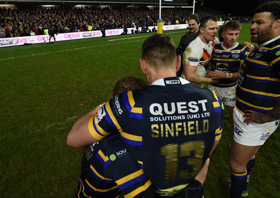 The image from the fundraising game between Leeds and Bradford in January 2020 that the statue is based on