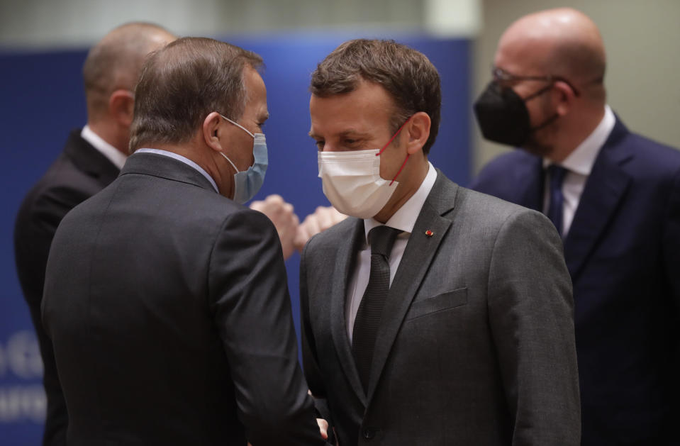 French President Emmanuel Macron, right, talks to Sweden's Prime Minister Stefan Lofven during an EU summit at the European Council building in Brussels, Friday, June 25, 2021. During the second of two days summit EU leaders are discussing the economic challenges the bloc faces due to coronavirus restrictions and will review progress on their banking union and capital markets union. (Olivier Hoslet, Pool Photo via AP)