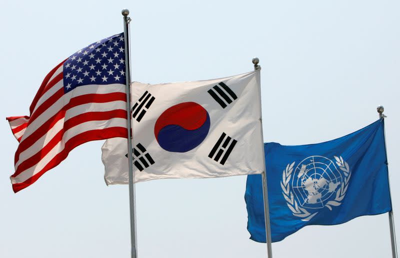 FILE PHOTO: Flags of the U.S., South Korea and the United Nations flap in the wind at the Korean War Memorial Museum in Seoul
