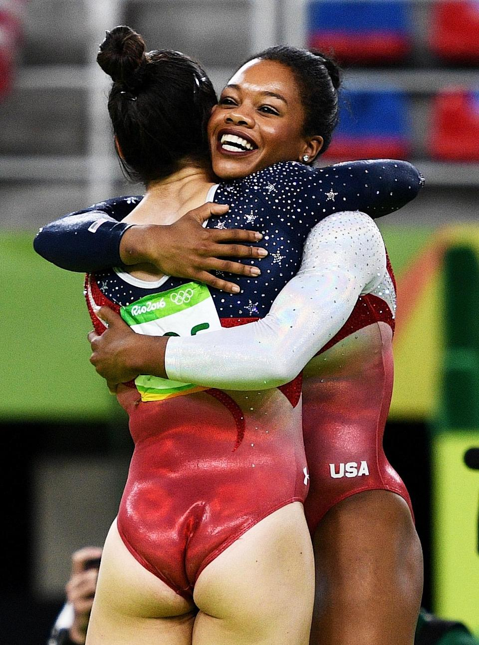 <p>Alexandra Raisman (L) and Gabrielle Douglas (R) of the United States celebrate winning the gold medal during the Artistic Gymnastics Women's Team Final on Day 4 of the Rio 2016 Olympic Games at the Rio Olympic Arena on August 9, 2016 in Rio de Janeiro, Brazil. (Photo by David Ramos/Getty Images) </p>