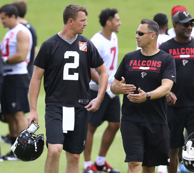 Atlanta Falcons offensive coordinator Steve Sarkisian works with Matt Ryan (2) during an NFL football minicamp in Flowery Branch, Ga., Thursday, June 14, 2018. (Curtis Compton/Atlanta Journal-Constitution via AP)