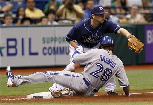 Toronto Blue Jays' Colby Rasmus slides into third base with a triple ahead of the throw to Tampa Bay Rays' Drew Sutton during the seventh inning of a baseball game, Wednesday, May 23, 2012, in St. Petersburg, Fla. (AP Photo/Chris O'Meara)