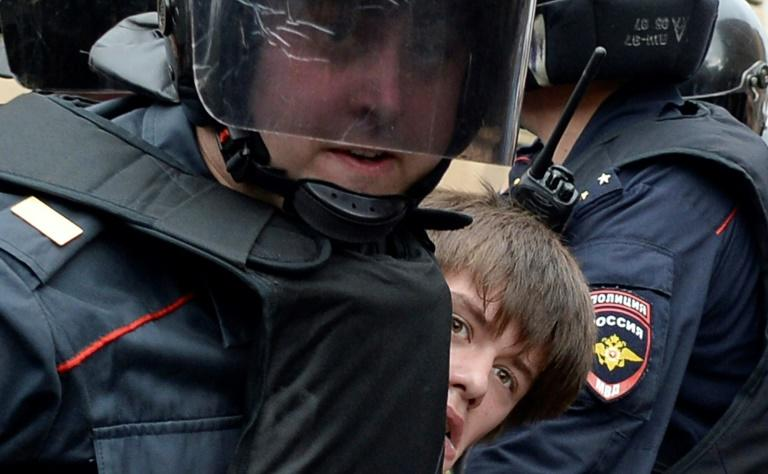 "Police detain a protester in Russia's second city Saint Petersburg, where a largely young crowd of around 1,000 people shouted ""shame"""