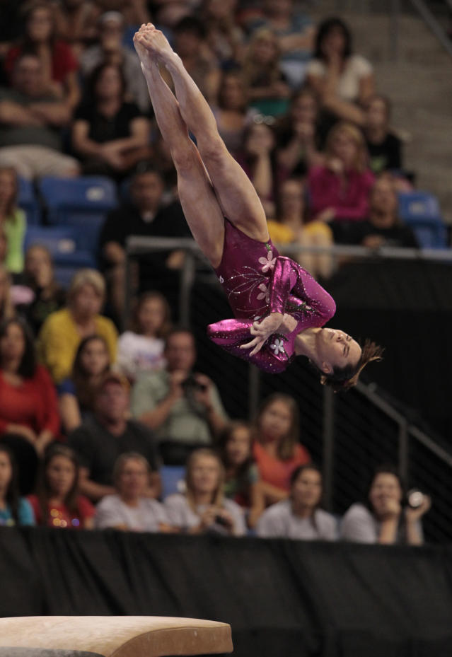McKayla Maroney performs in the vault during the women's senior division at the U.S. gymnastics championships on Friday, June 8, 2012, in St. Louis. (AP Photo/Jeff Roberson)