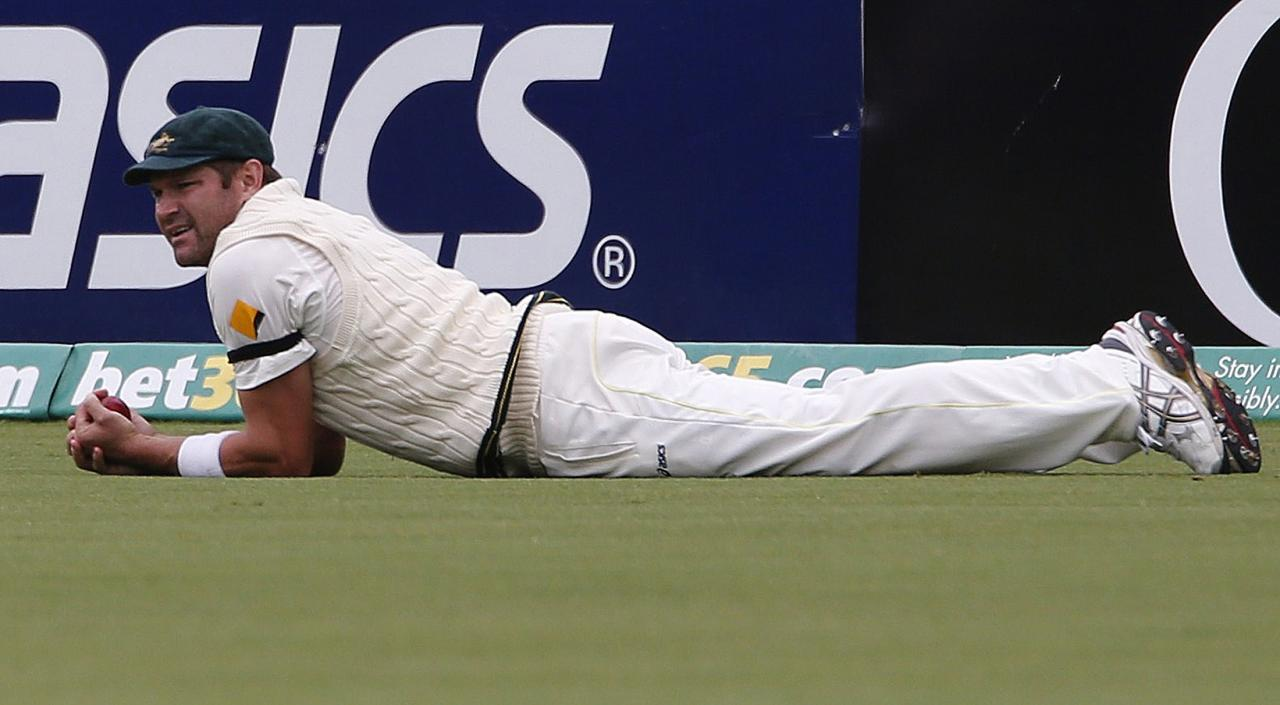 Australia's Ryan Harris looks on after taking a catch to dismiss England's Matt Prior during the fifth day's play in the second Ashes cricket test at the Adelaide Oval December 9, 2013. REUTERS/David Gray (AUSTRALIA - Tags: SPORT CRICKET)