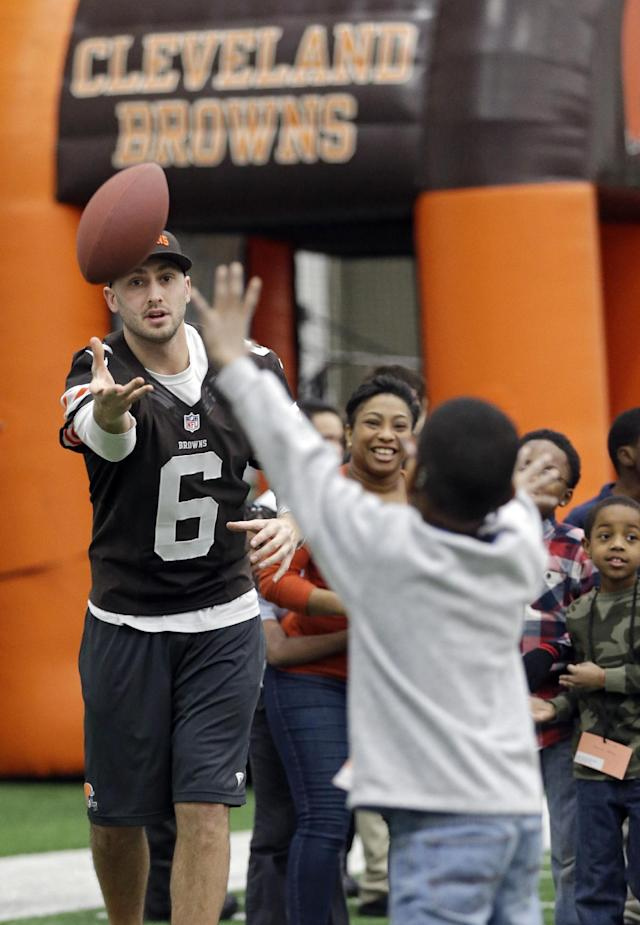 Cleveland Browns quarterback Brian Hoyer (6) throws to area Special Olympians at the NFL team's Play 60 football festival at their practice facility in Berea, Ohio Thursday, Feb. 13, 2014. The Browns hosted over 700 students from the Cleveland school district for the event. (AP Photo/Mark Duncan)
