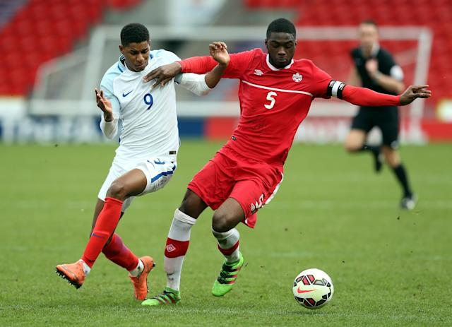 DONCASTER, ENGLAND - MARCH 27: Marcus Rashford of England (L) challenged by Fikayo Tomori of Canada during the U20 International Friendly match between England and Canada at the Keepmoat Stadium on March 27, 2016 in Doncaster, England. (Photo by Nigel Roddis/Getty Images)
