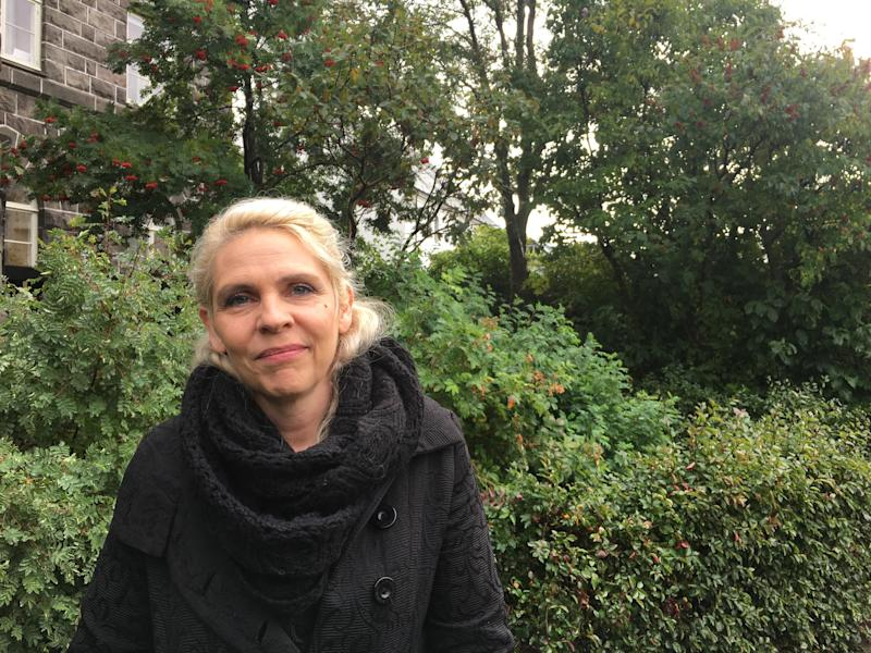 Birgitta Jónsdóttir, in the garden outside Iceland's Parliament House, on Monday morning, says she worries the prime minister will take advantage of his time before an Oct. 28 snap election. (Alexander C Kaufman / HuffPost)