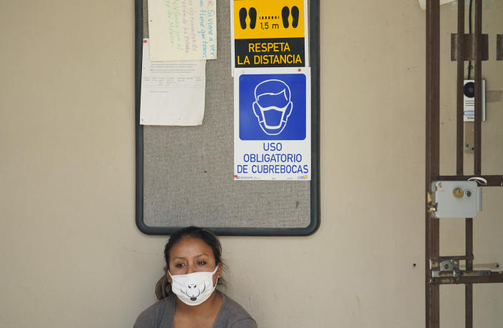 A woman seeking asylum in the United States and living at a camp in Matamoros, Mexico, waits for COVID-19 antibody test result at a clinic, Tuesday, Nov. 17, 2020. Led by U.S. military veterans, Global Response Management is staffed by volunteers primarily from the U.S. and paid asylum seekers who were medical professionals in their homelands. The group has treated thousands of migrants over the past year at two clinics in Matamoros, including one inside the camp. (AP Photo/Eric Gay)